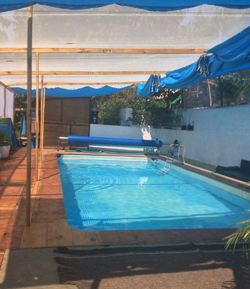 fluidsymmetry therapy pool building shades open