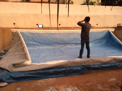 Fluidsymmetry therapy pool building erecting the pool
